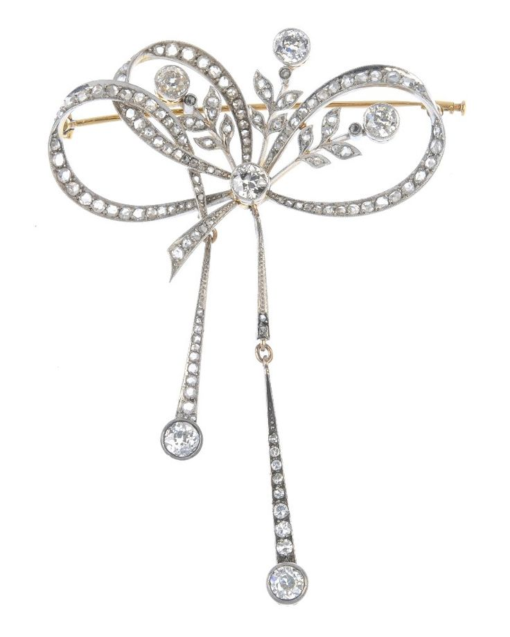 An early 20th century silver and 15ct gold diamond brooch. The rose-cut diamond ...