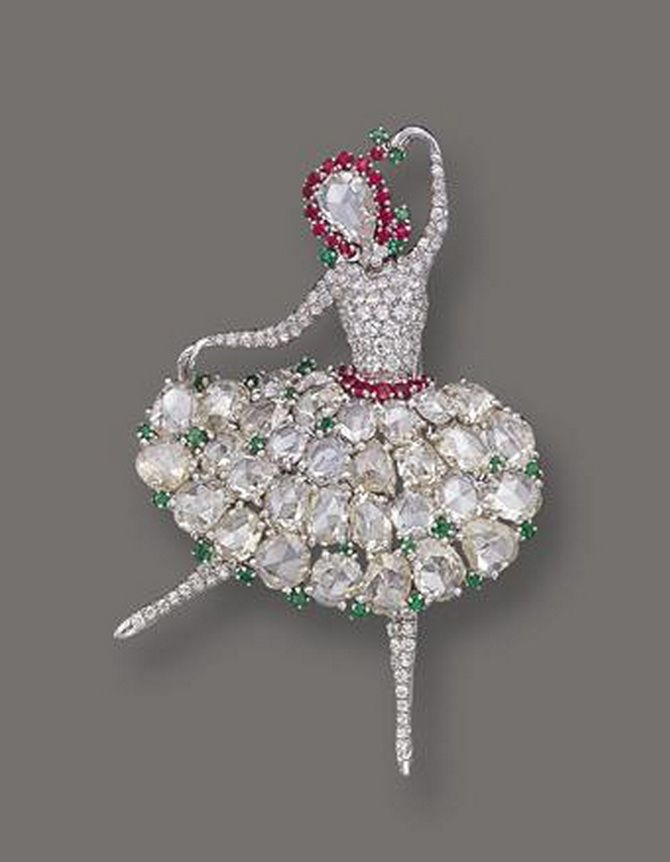 DIAMOND, RUBY AND EMERALD BALLERINA BROOCH, V AN CLEEF & ARPELS, NEW YORK, 1943 ...