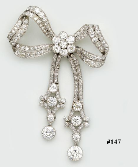 Diamond and platinum bow brooch. This large and beautiful bow brooch has wonderf...