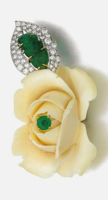 Ivory, emerald and diamond brooch, Cartier, 1950s Designed as a carved ivory ros...