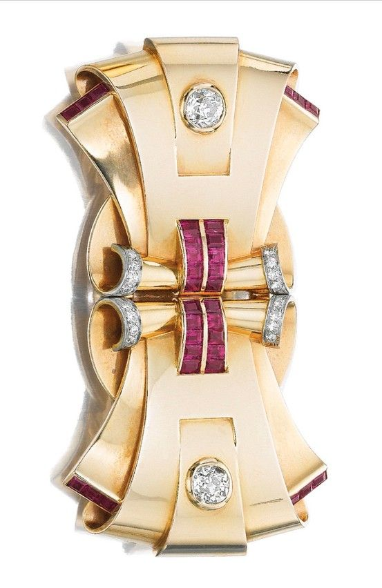 PAIR OF RUBY AND DIAMOND DOUBLE CLIP BROOCHES, ONE TIFFANY & CO., 1940S. One dou...