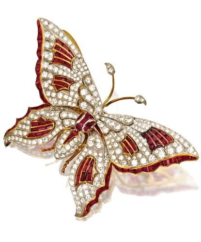 RUBY AND DIAMOND BUTTERFLY BROOCH Round diamonds weighing approximately 10.20 ca...