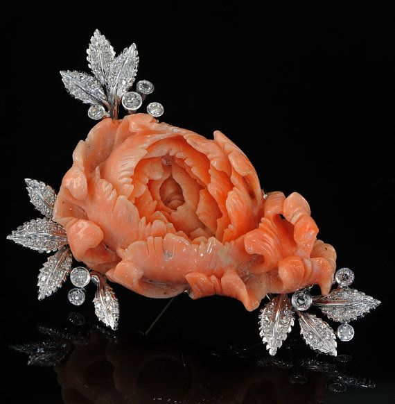 Stunning large coral rose and diamond brooch, circa 1960's.