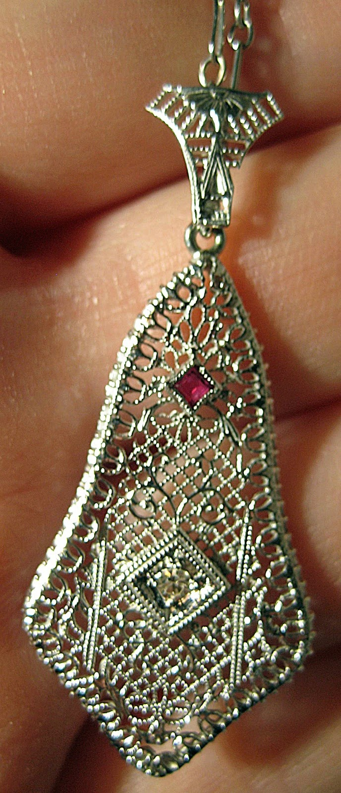 Art Deco diamond and ruby filigree pendant at The Antique Guild in Old Town Alex...