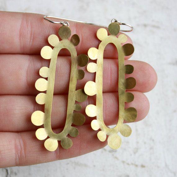 Bold brass earrings.