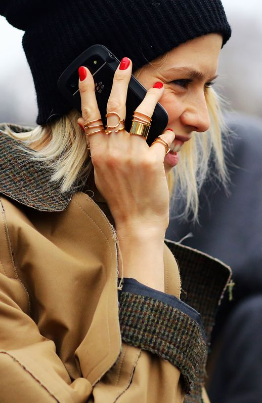 red nails and lots of rings.