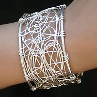 Cuff bracelet | Carlos and Cynthia Rendon.  Sterling silver