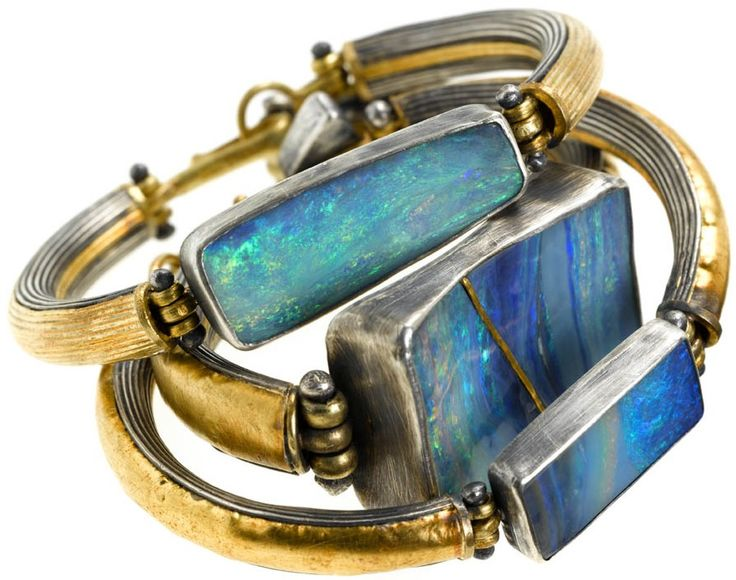 Opals set in bracelets with silver and gold.
