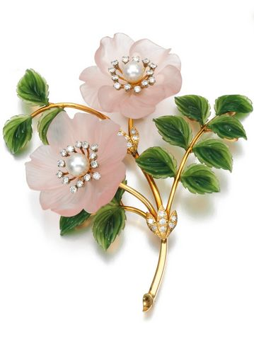 A gem set and diamond brooches, circa 1960  A brooch designed as a spray of wild...