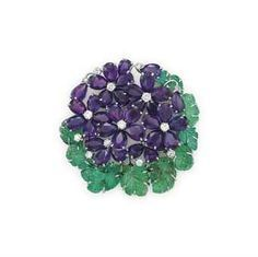 AN AMETHYST, EMERALD AND DIAMOND BROOCH, BY CARTIER - Designed as a series of pe...
