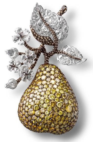 Carnet Pear Clip with white, fancy vivid and intense yellow and brown diamonds i...