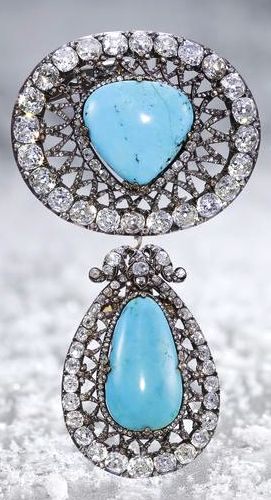 Turquoise and diamond pendants.   The first brooch of oval outline centering a t...