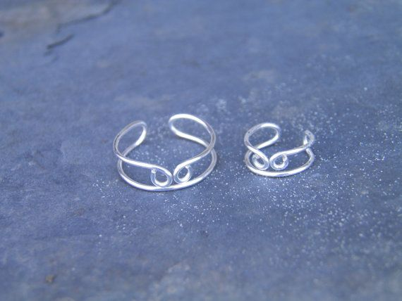 Ear cuff, toe ring... Coming together... silver wire wrapped toe ring and ear cu...