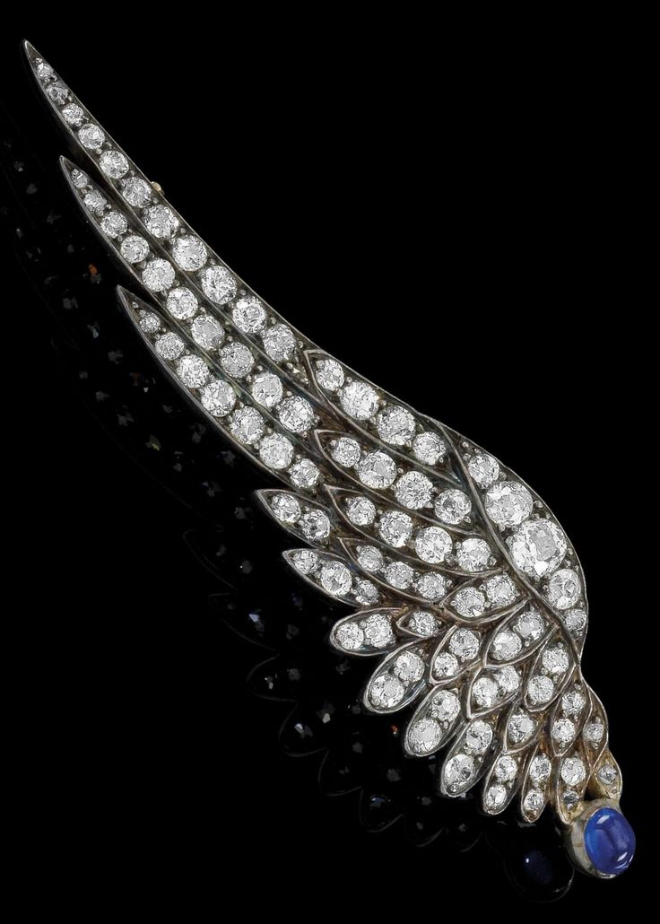 A Belle Epoque gold, silver, diamond and sapphire brooch, circa 1900. Designed a...