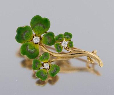 A gold, enamel and diamond lucky four-leaf-clover brooch.