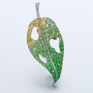 A platinum, sapphire, demantoid garnet and diamond leaf brooch by Gimel, Japan. ...