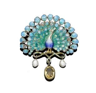 An enamel, pearl and citrine peacock brooch, circa 1900. The peacock with fanned...