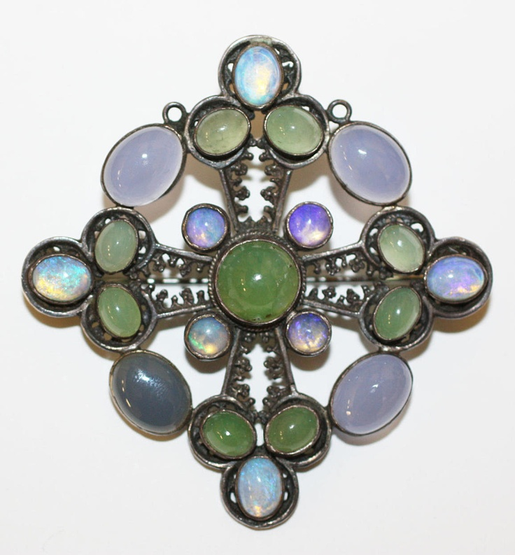 Sybil Dunlop: An opal and agate pendant/brooch  The pierced lozenge mount collet...