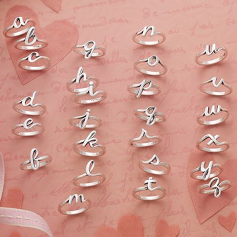 Compose a love letter with our new sterling silver Script Initial Rings. Wear on...