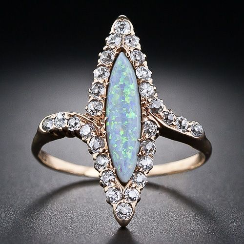 Victorian Navette Opal and Diamond Ring with 28 Old Mine Cut Diamonds.
