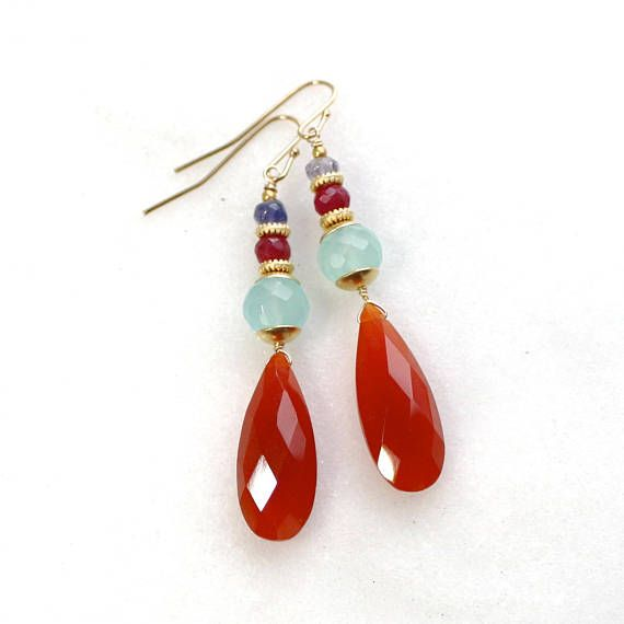 A gorgeous pair of vibrant orange carnelian of the finest quality - these one of...