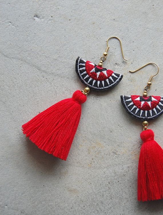 These are a hand-crafted pair of earrings that have been made from embroidered H...