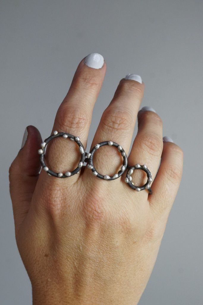 small, medium, and large handmade mixed metal silver on steel circle rings