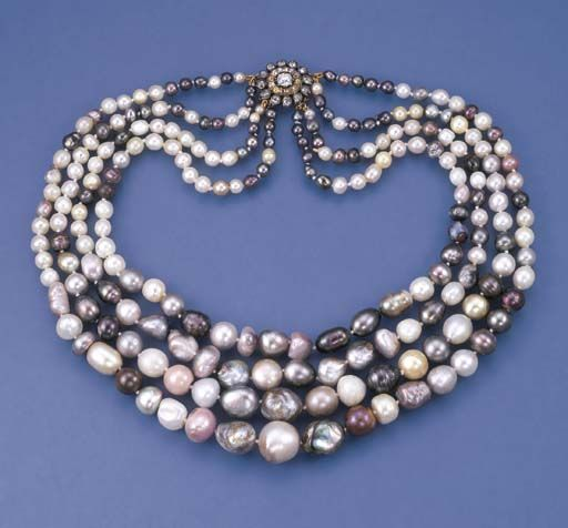 Diamond, pearl, silver and gold necklace.