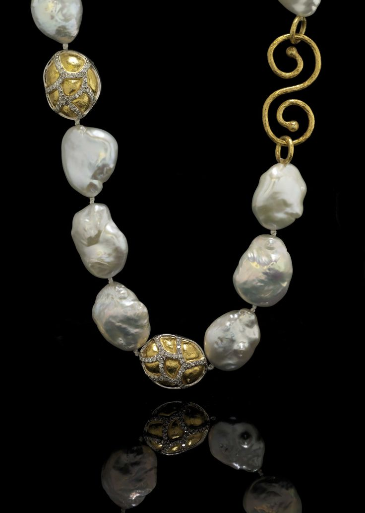 Diamond, pearl and gold necklace.