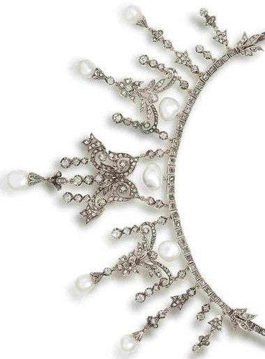 A 19th century natural pearl and diamond necklace. The rose-cut diamond chain su...