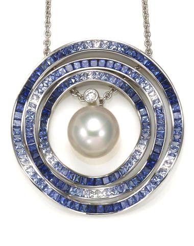 A South Sea cultured pearl, sapphire and diamond Ocean Ripple pendant with chain...