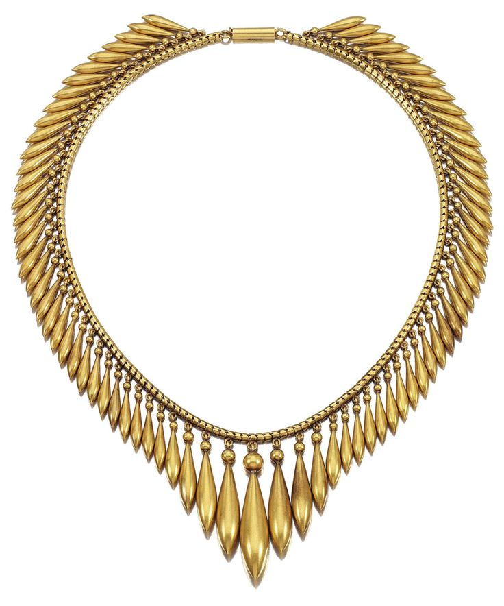 A gold archeological revival necklace. Designed as a graduated fringe of tapered...