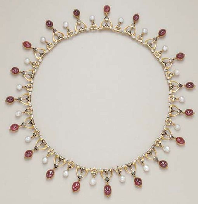 AN ANTIQUE ENAMEL, PEARL AND GARNET NECKLACE, BY CARLO GIULIANO Designed as a se...