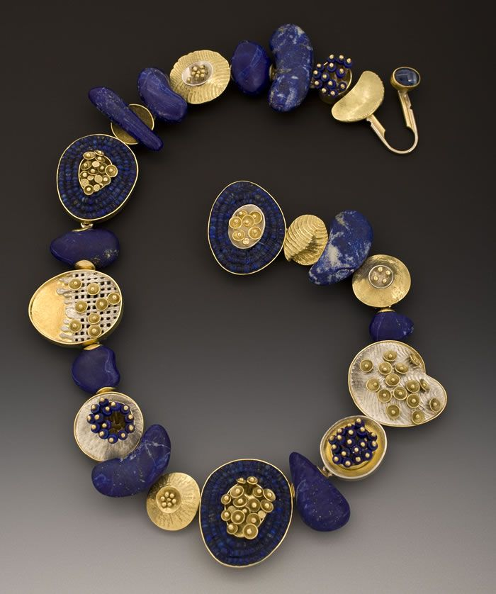Carved lapis beads