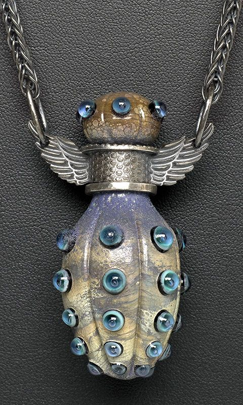Glass and silver bottle necklace.