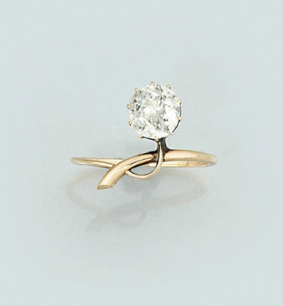 An Edwardian diamond single stone ring   The old brilliant-cut diamond, weighing...