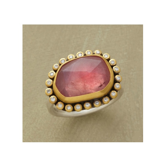 pink cosmos ring. Irregular facets span a luminous pink sapphire universe rimmed...