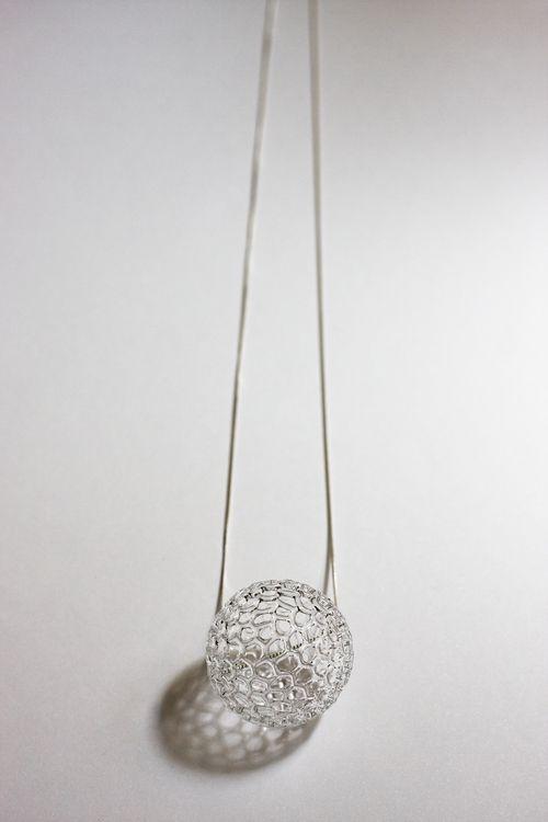 A glass necklace, by Harrys.