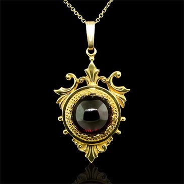 Gold and garnet pendant.