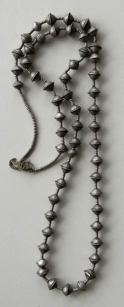 Necklace, made from silver beads.