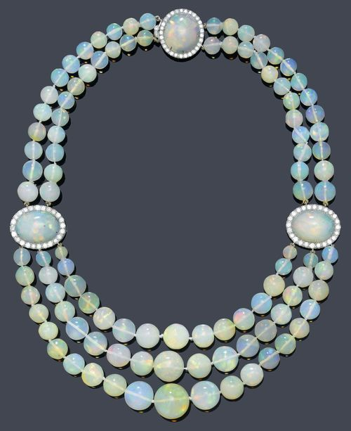 Opal and diamond necklace, circa 1950. 103 opal beads, opal cabochons surrounded...