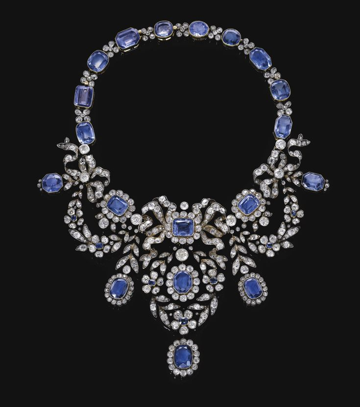 Sapphire and diamond necklace, late 19th century. Of bow and foliate swag design...