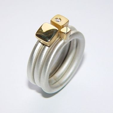 Silver ring set with diamond & square gold detail by Paul  Finch