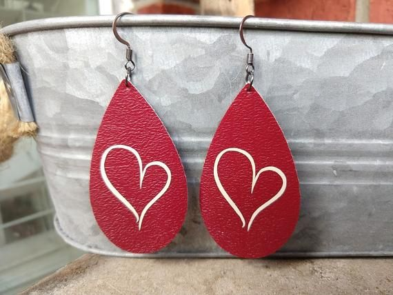 Celebrate Valentines Day with these festive heart earrings. Great for February, ...