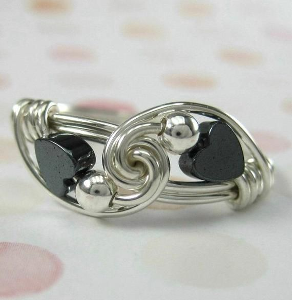 Wire wrapped sweetheart ring in sterling silver with hematite hearts. A sweethea...