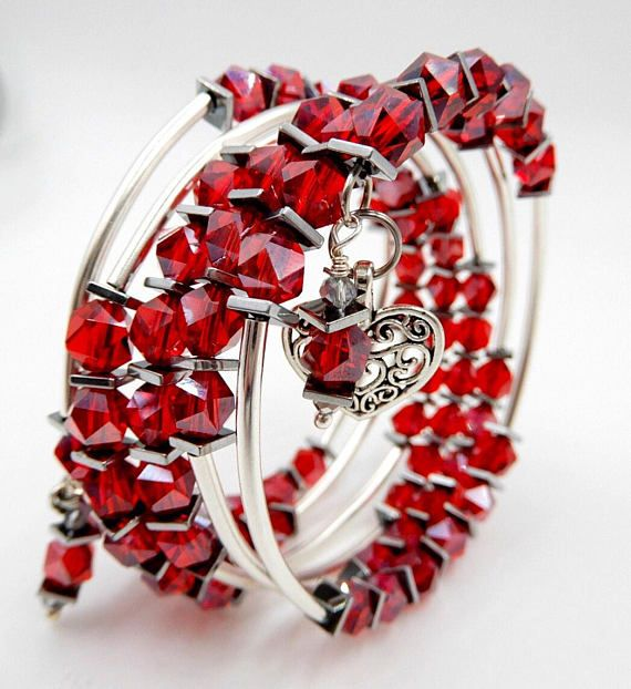 This gorgeous red beaded wrap bracelet is made on silver memory wire with 5 rows...