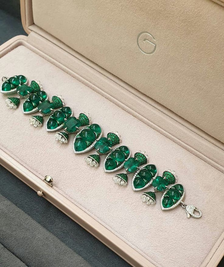 Beautiful cabochon cut emerald bracelet designed to stand out from the rest. Dia...