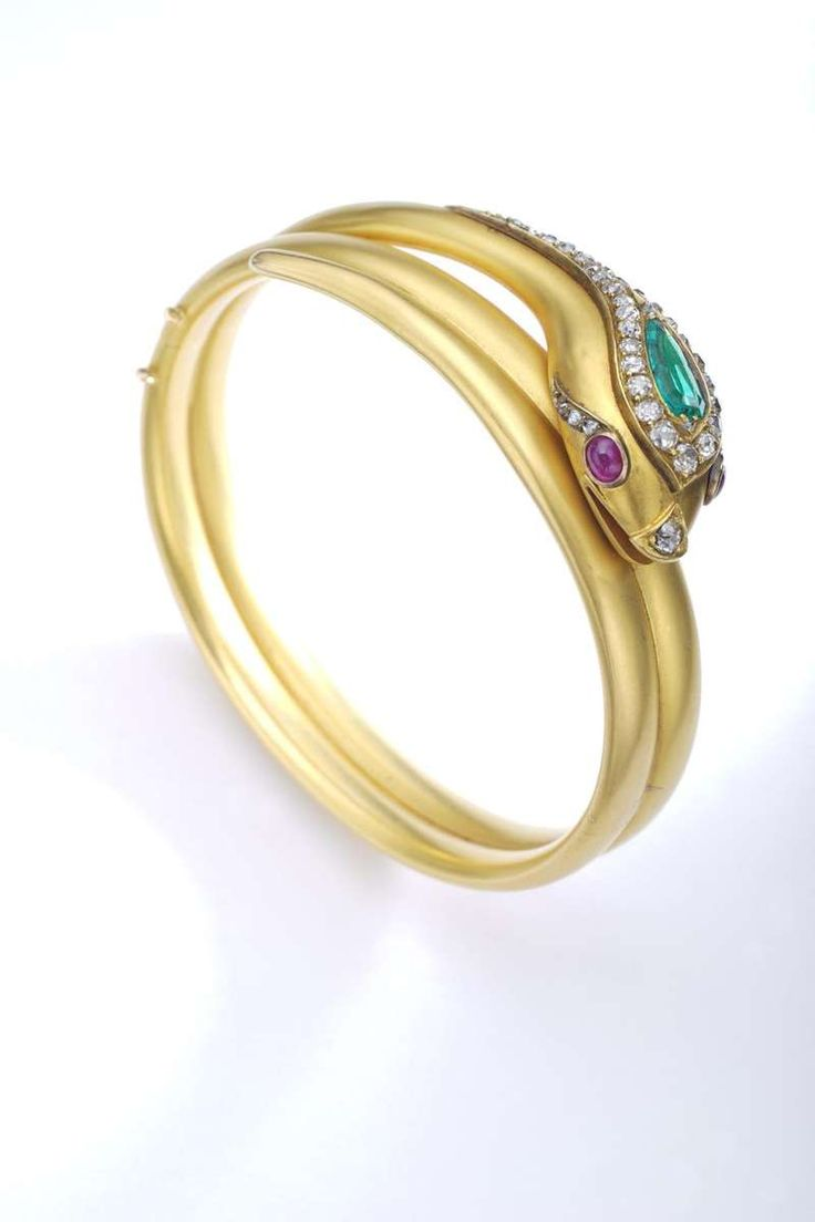 For Sale on 1stdibs - A Late 19th Century Emerald, Ruby and Diamond Bangle. Mode...