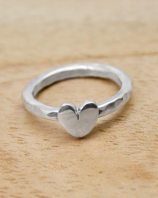 A pretty handmade silver ring featuring a highly polished heart on a hammered sh...