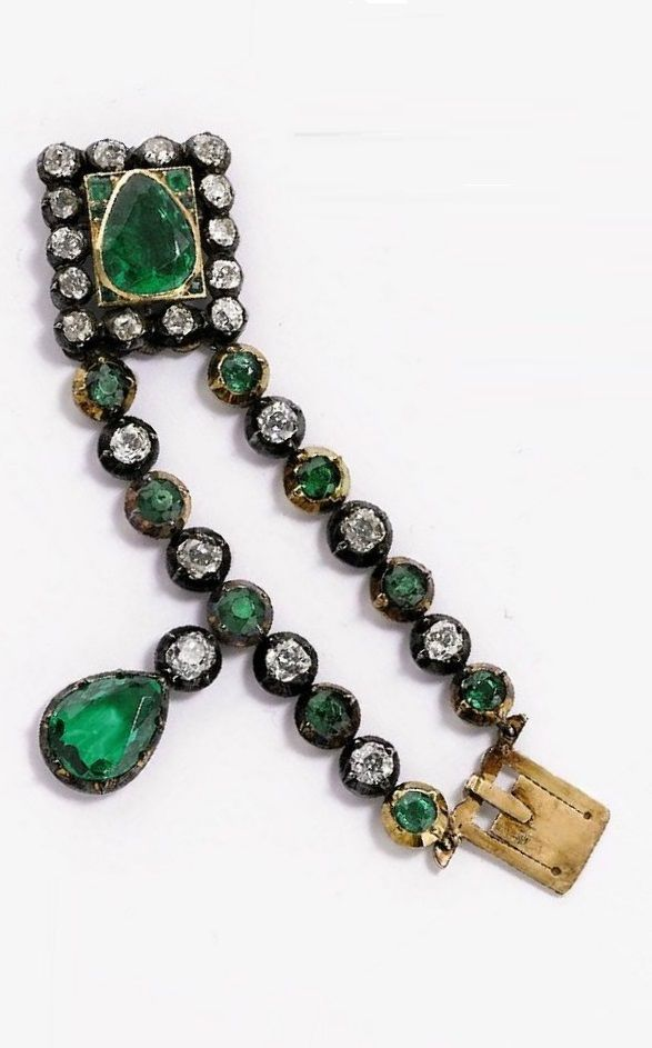 An antique emeral and diamond clasp, 19th century. Originally part of a another ...